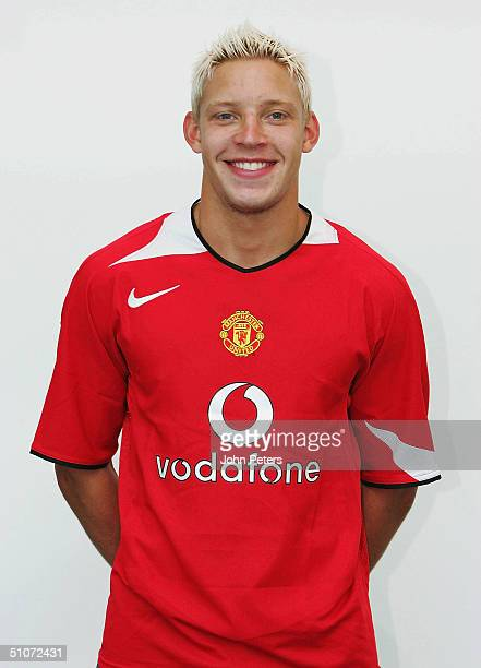 Alan Smith of Manchester United poses in the new Manchester United home shirt at Carrington Training Ground on July 15 2004 in Manchester England