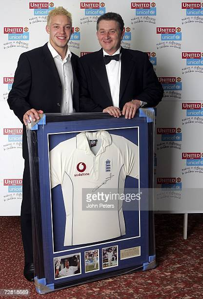 Alan Smith of Manchester United presents the auction winner with a signed Andrew Flintoff shirt during the annual United for Unicef charity dinner at...
