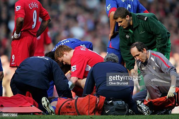 Alan Smith of Manchester United receives attention from medical staff and John Arne Riise of Liverpool after breaking his leg during the FA Cup fifth...