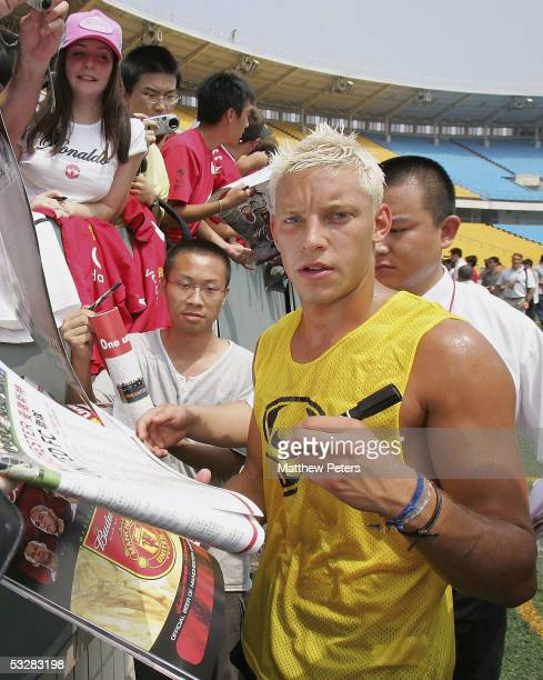 Alan Smith of Manchester United signs autographs after a training session at Workers Stadium on July 25 2005 in Beijing China