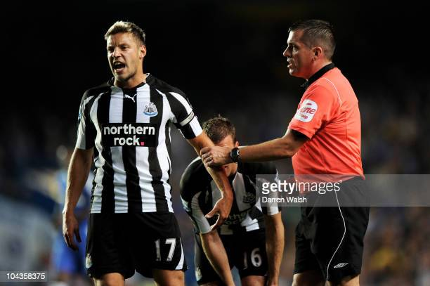 Alan Smith of Newcastle reacts as he is lectured by Referee Phil Dowd during the Carling Cup third round match between Chelsea and Newcastle United...