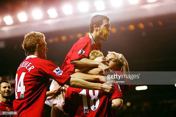 Alan Smith Paul Scholes Roy Keane Darren Fletcher and Ryan Giggs celebrate a goal during the Barclays Premiership match between Manchester United and...