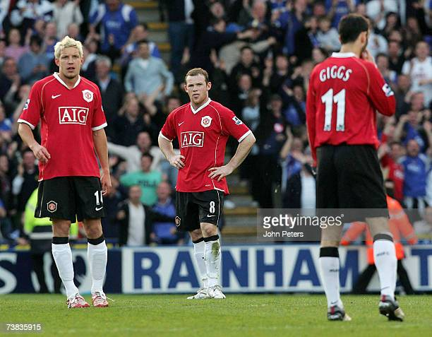 Alan Smith Wayne Rooney and Ryan Giggs of Manchester United react to Rio Ferdinand scoring an owngoal during the Barclays Premiership match between...
