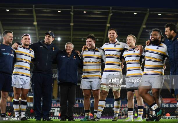 Alan Solomons Director of Rugby of Worcester Warriors smiles alongside players and coaching staff after his sides victory over Ospreys during the...