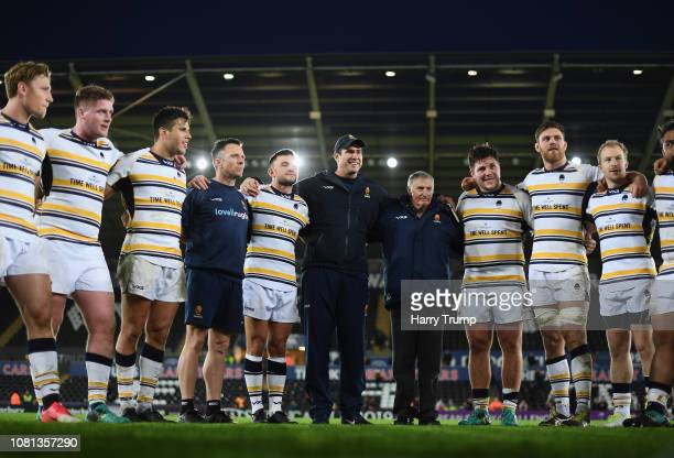 Alan Solomons, Director of Rugby of Worcester Warriors smiles alongside players and coaching staff after his sides victory over Ospreys during the...