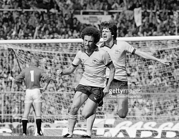 Alan Sunderland of Arsenal celebrates with Steve Walford after scoring the winning goal during the FA Cup Final between Arsenal and Manchester United...