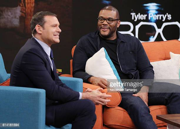 Alan Tacher and Tyler Perry are seen on the set of Despierta America to promote the film Boo A Madea Halloween at Univision Studios on October 12...
