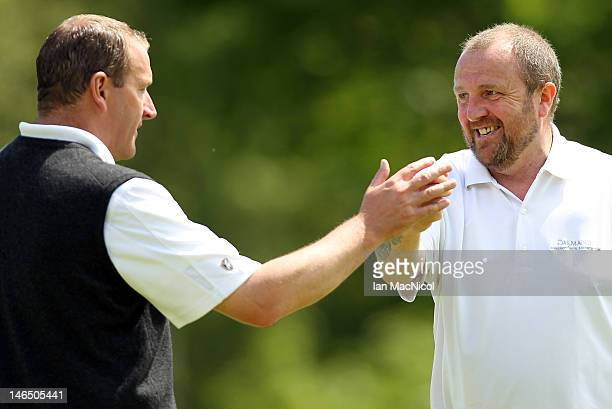 Alan Tait and John McHardy of Marriott Dalmahoy Golf and Country Club congratulate one another during the Virgin Atlantic PGA National Pro-Am...