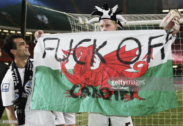 Alan Tate and Roberto Martinez of Swansea City celebrate with a banner after Swansea City's 2-1 victory in The Football League Trophy Final match...
