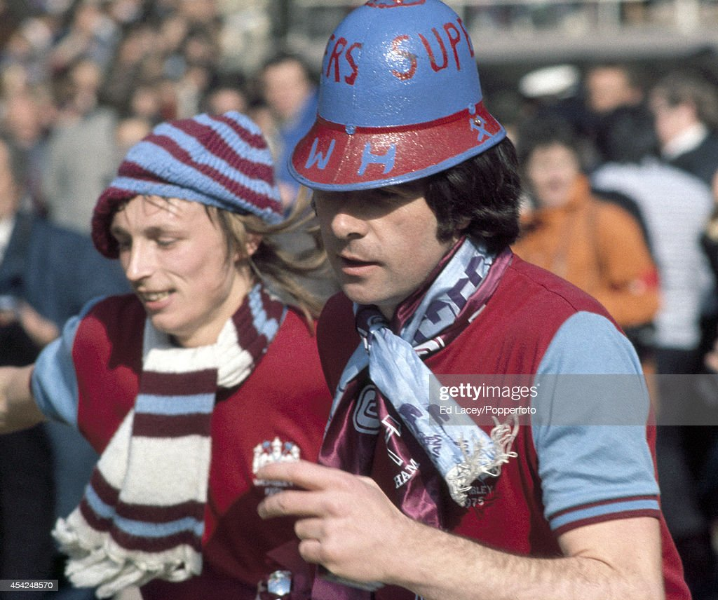 Alan Taylor (left) and Bobby Gould of West Ham United celebrate their victory against Fulham in the FA Cup Final at Wembley Stadium in London on 3rd May 1975. West Ham United won 2-0.