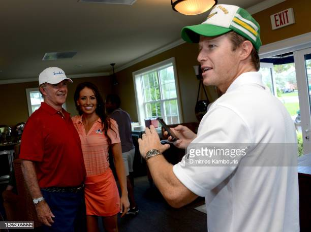 Alan Thicke Holly Sonders and Billy Bush attend the Golf Clinic with Greg Norman and Golf Tournament during Day Three of the Sandals Emerald Bay...