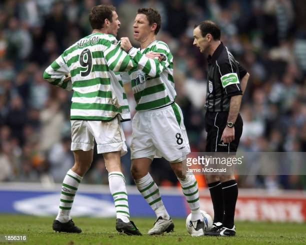 Alan Thompson holds of teammate Chris Sutton of Celtic from attacking the Referee Mike McCurry as tempers rise during the Scottish Premier League...