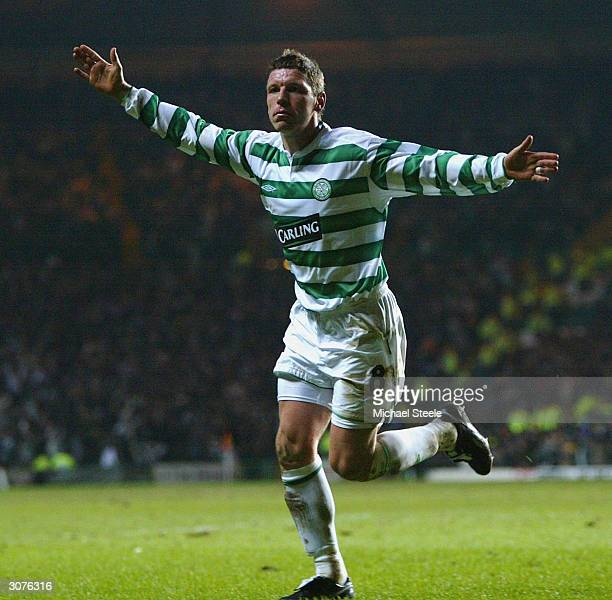 Alan Thompson of Celtic celebrates after scoring the first goal during the UEFA Cup Fourth Round First Leg match between Celtic and Barcelona at...