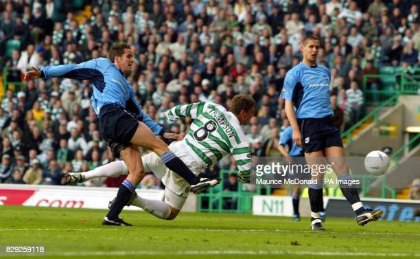 Alan Thompson takes the second goal for Celtic as Lee Mair and Lee Wilkie look on in the Celtic v Dundee Scottish Premier League match