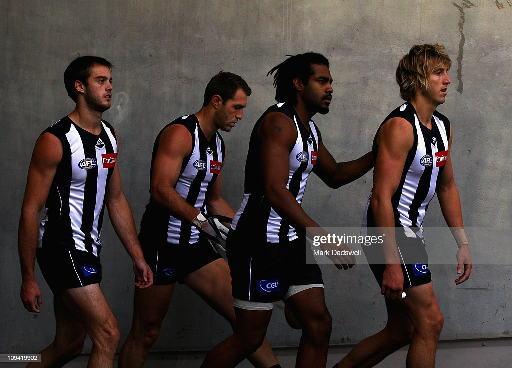 Alan Toovey, Travis Cloke, Harry O'Brien and Dale Thomas of the Magpies make their way up the race for the start of the NAB Cup Quarter Final match between the Collingwood Magpies and the Sydney Swans at Etihad Stadium on February 25, 2011 in Melbourne, Australia.