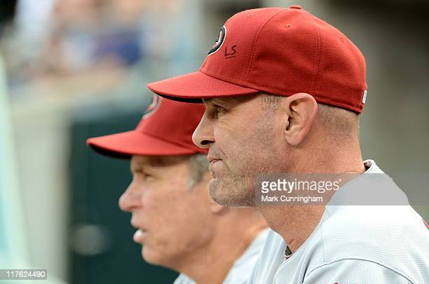 Alan Trammell and Kirk Gibson of the Arizona Diamondbacks look on against the Detroit Tigers during the game at Comerica Park on June 25 2011 in...