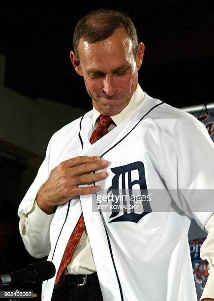 Alan Trammell looks down at the Olde English 'D' on the uniform he was given after being named the Detroit Tigers' new manager at Joe Louis Arena in...