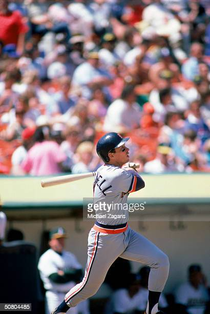 Alan Trammell of the Detroit Tigers watches the flight of the ball as he follows through on a swing during a game on May 2, 1987 at Oakland-Alameda...