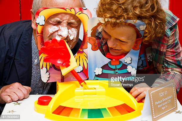 Alan Twigg and Archie Twigg play with the Pieface Showdown game as Hamley's announce it's top ten toys for Christmas at Hamleys on October 6 2016 in...