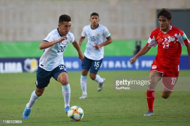 Alan Velasco of Argentina and Amadoni Kamolov of Tajikistan during the FIFA U17 World Cup Brazil 2019 Group E match between Argentina and Tajikistan...