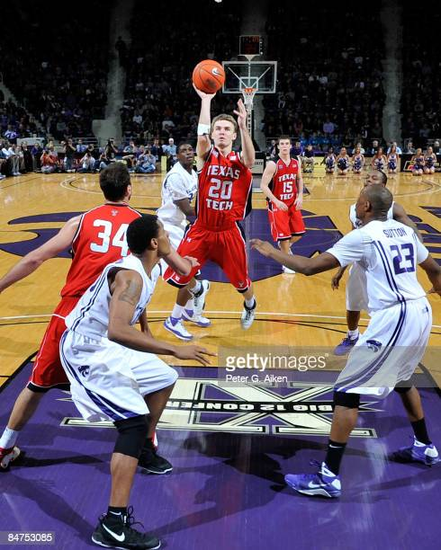 Alan Voskuil of the Texas Tech Red Raiders puts up a shot over pressure from defenders Dominique Sutton and Ron Anderson of the Kansas State Wildcats...