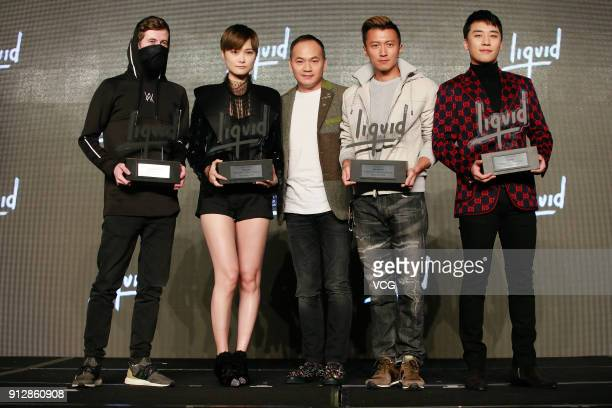 Alan Walker singers Chris Lee Nicholas Tse and SeungRi attend a news conference after Chinese internet giant Tencent and Sony Music Entertainment...