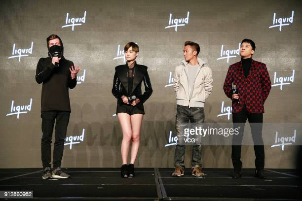 DJ Alan Walker singers Chris Lee Nicholas Tse and SeungRi attend a news conference after Chinese internet giant Tencent and Sony Music Entertainment...