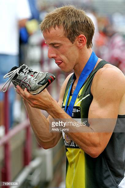 Alan Webb autographs a shoe after winning the men's 1500 meter run during day four of the AT&T USA Outdoor Track and Field Championships at IU...