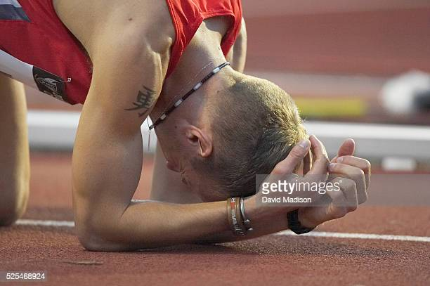 Alan Webb emotes on the track after completing the men's 1500m semifinal at the US Outdoor Championships at Stanford, California. Webb qualified for...