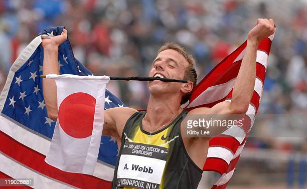 Alan Webb holds United States and Japanese flags after winning the 1,500 meters in a meet-record 3:34.82 in the USA Track & Field Championships at...
