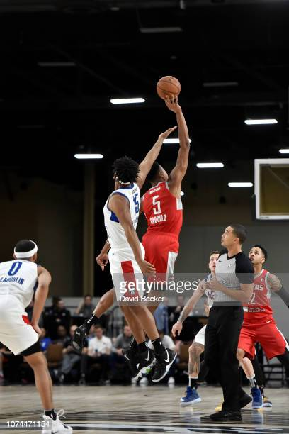 Alan Williams of the Long Island Nets and Bruno Caboclo of the Rio Grande Valley Vipers jump for the opening tipoff during the NBA G League Winter...