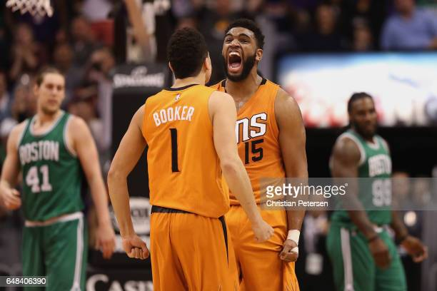 Alan Williams of the Phoenix Suns celebrates with Devin Booker after scoring against the Boston Celtics during the second half of the NBA game at...