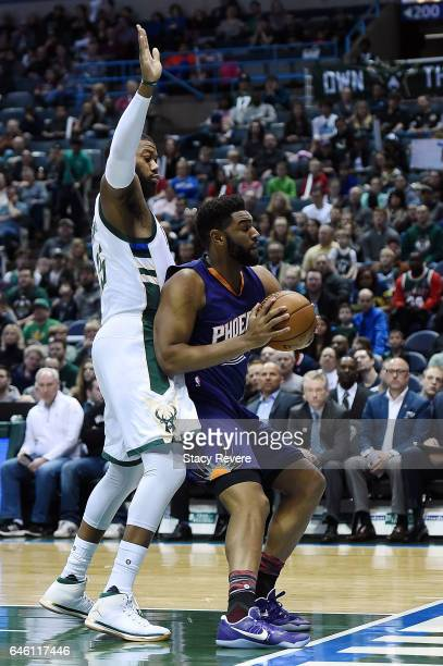 Alan Williams of the Phoenix Suns is defended by Greg Monroe of the Milwaukee Bucks during a game at the BMO Harris Bradley Center on February 26...