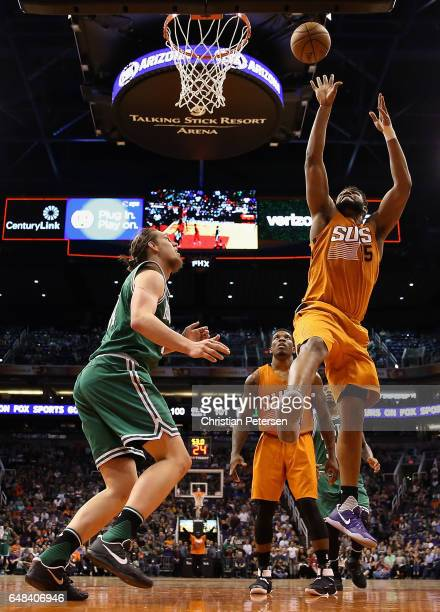 Alan Williams of the Phoenix Suns puts up a shot over Kelly Olynyk of the Boston Celtics during the second half of the NBA game at Talking Stick...