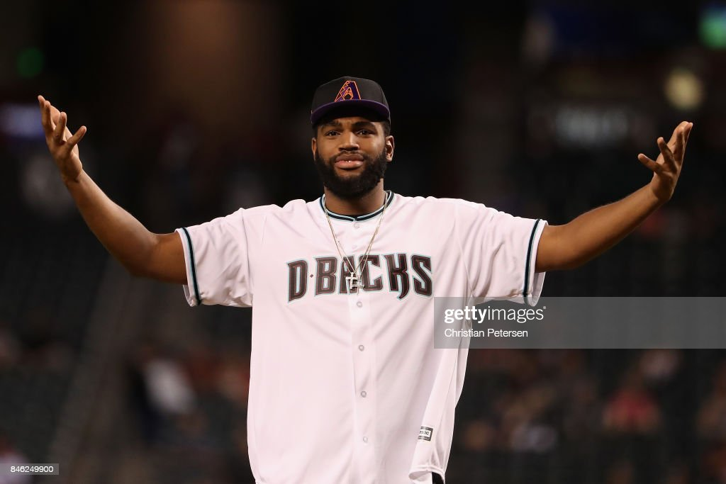 Alan Williams of the Phoenix Suns reacts after throwing out the ceremonial first pitch before the MLB game between the Arizona Diamondbacks and the Colorado Rockies at Chase Field on September 12, 2017 in Phoenix, Arizona.