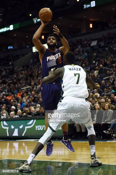 Alan Williams of the Phoenix Suns shoots over Thon Maker of the Milwaukee Bucks during the first half of a game at the BMO Harris Bradley Center on...