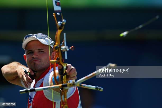 Alan Wills of Great Britain shoots in the Men's Individual 1/8 Eliminations at the Olympic Green Archery Field on Day 7 of the Beijing 2008 Olympic...