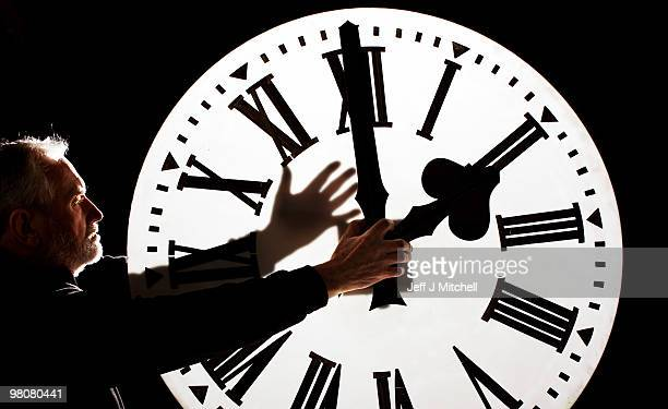 Alan Wilson, Director of James Ritchie & Son clockmakers, founded in 1809, adjusts a clock face to British Summer Time on March 26, 2010 in...