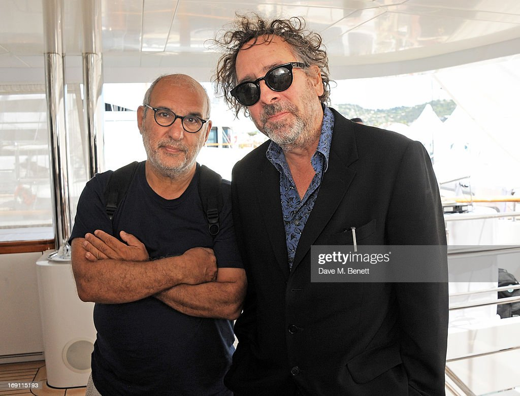 Alan Yentob (L) and Tim Burton attend a lunch hosted by Len Blavatnik, Harvey Weinstein and Warner Music during the 66th Cannes Film Festival on board the Odessa at Old Port on May 19, 2013 in Cannes, France.