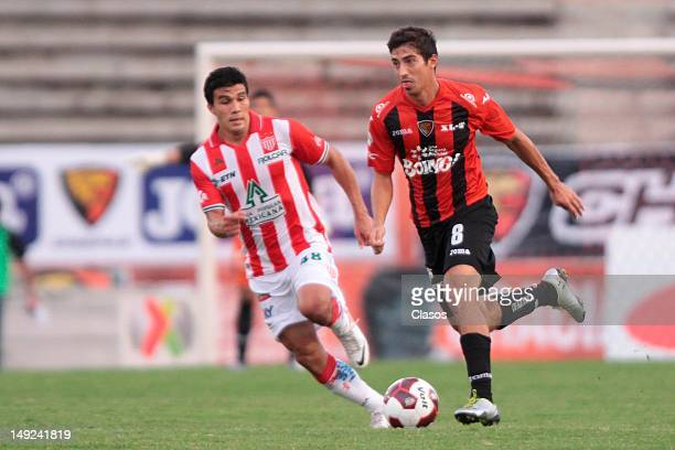 Alan Zamora of Nexaca and Ezequiel Orozco of Jaguares fight for the ball during a match between Jaguares v Necaxa as part of the Copa MX 2012 at...