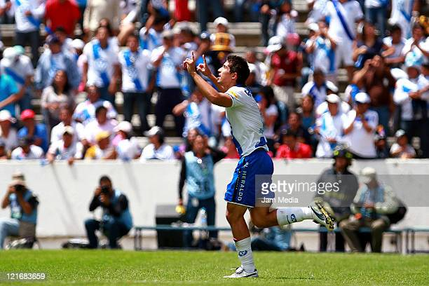 Alan Zamora of Puebla celebrate a scored goal during a match between Puebla and Pumas as part of the Apertura 2011 at Cuauhtemoc Stadium on August...