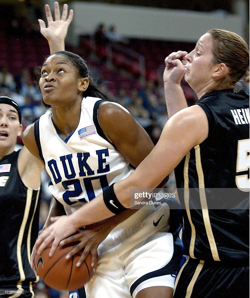 Alana Beard 20 is fouled by Emily Heikes 52 on a drive to the basket. Duke Blue Devils defeats the Purdue Boilmakers 93-63.