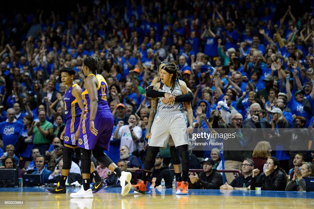 Alana Beard #0 and Chelsea Gray #12 of the Los Angeles Sparks react after being unable to inbound the ball in time as Maya Moore #23 and Seimone Augustus #33 of the Minnesota Lynx celebrate during the fourth quarter of Game Two of the WNBA Finals on September 26, 2017 at Williams in Minneapolis, Minnesota. The Lynx defeated the Sparks 70-68.