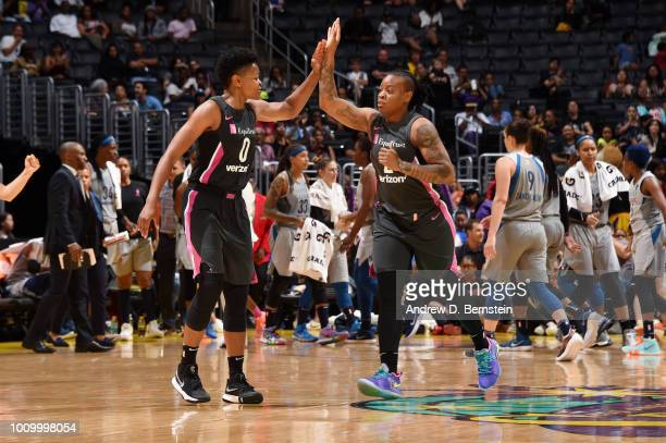 Alana Beard and Riquna Williams of the Los Angeles Sparks high five during the game against the Minnesota Lynx on August 2 2018 at STAPLES Center in...