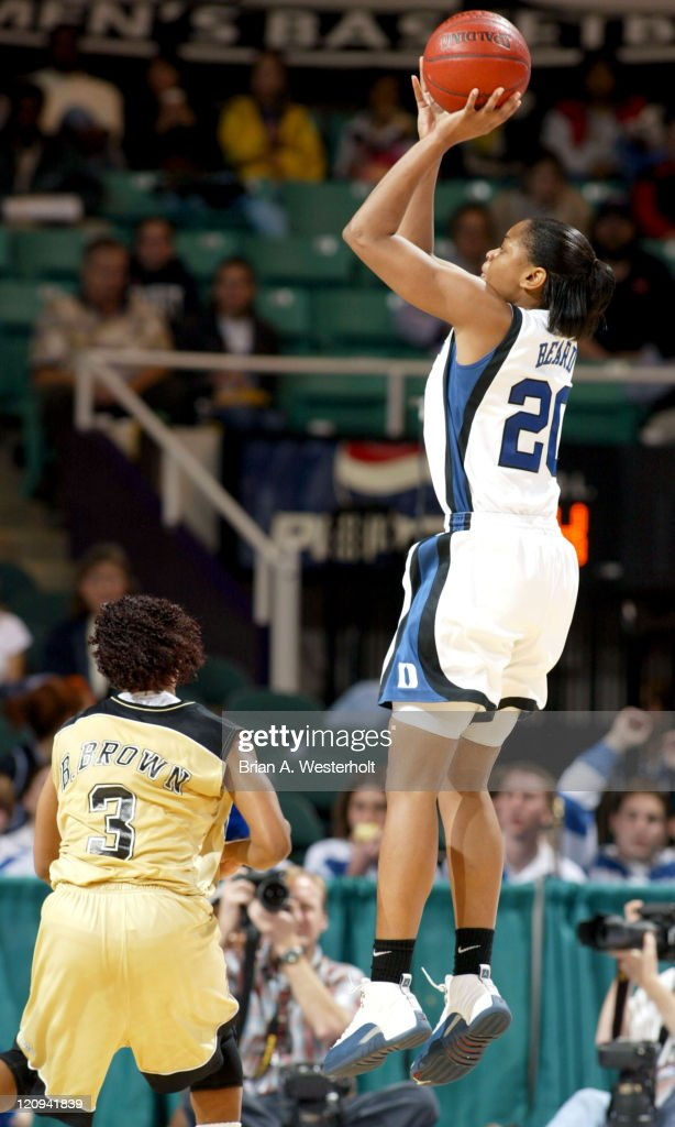 Alana Beard (#20) launches a jump shot over Bianca Brown (#3) during the first half of #2 Duke's 77-59 victory over Wake Forest at the ACC Women's Basketball Tournament, March 6, 2004.