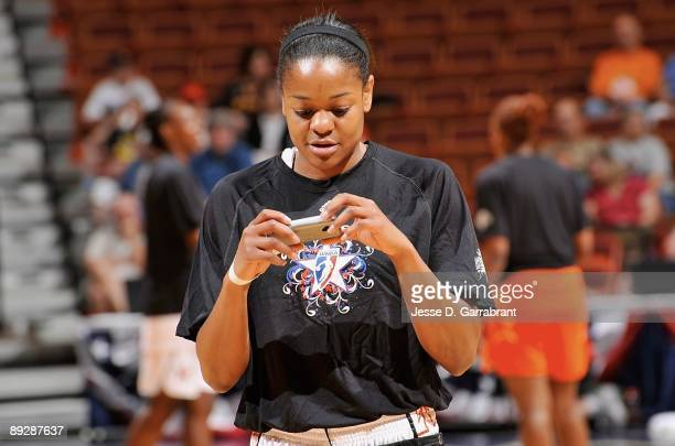 Alana Beard of the Eastern Conference sends a Twitter message during warm ups before the 2009 WNBA AllStar Game at Mohegan Sun Arena on July 25 2009...