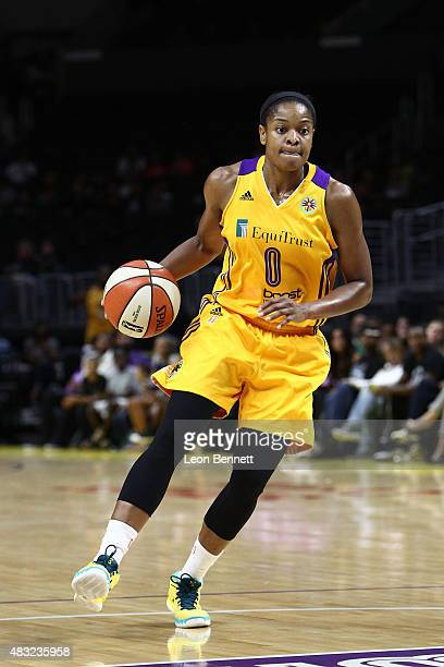 Alana Beard of the Los Angeles Spark handles the ball against the Tulsa Shock in a WNBA game at Staples Center on August 6 2015 in Los Angeles...