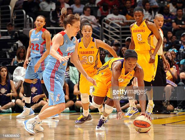Alana Beard of the Los Angeles Sparks dives for the loose ball against Laurie Koehn of the Atlanta Dream at Staples Center on July 8 2012 in Los...