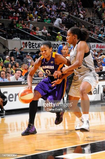 Alana Beard of the Los Angeles Sparks drives to the basket against Shenise Johnson of the San Antonio Silver Stars at ATT Center on June 28 2012 in...