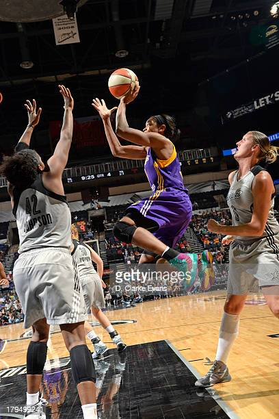 Alana Beard of the Los Angeles Sparks drives to the basket against the San Antonio Silver Stars at ATT Center on August 31 2013 in San Antonio Texas...